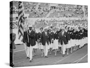 Rafer Johnson Leading USA Athletes During the Opening Day. 1960 Olympics. Rome, Italy by Mark Kauffman