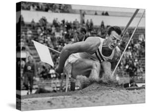 Robert B. Mathias Grimacing with the Effort of His 22 Foot 11 Inch Leap at 1952 Olympics by Mark Kauffman