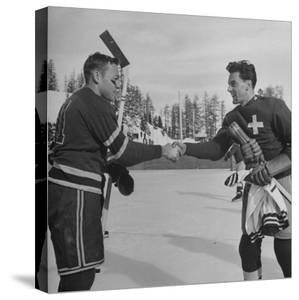 The Usa Team Giving the Swiss a Sweater and a Friendly Handshake before the Game by Mark Kauffman