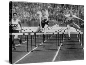 US Runner Fanny Blankers Koen Setting Olympic Record of 11.2 Seconds in 80 Meter Hurdles by Mark Kauffman