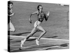 Wilma Rudolph, Across the Finish Line to Win One of Her 3 Gold Medals at the 1960 Summer Olympics by Mark Kauffman