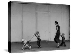 Young Housewife Walking with Her Three Children by Mark Kauffman