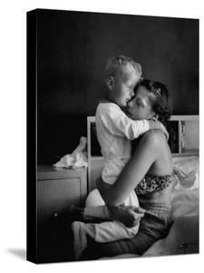 Young Mother Hugging One of Her Sons by Mark Kauffman