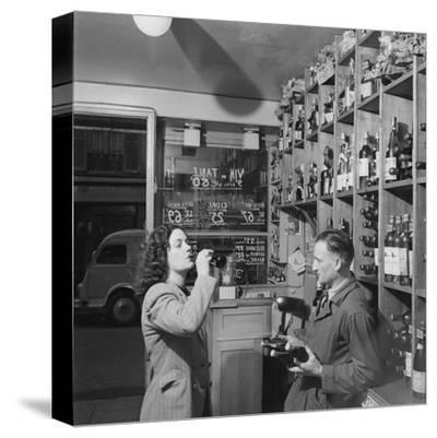 Young Woman Drinking a Bottle of Coca Cola in a Shop, Paris, France, 1950
