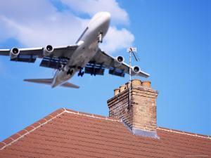 Low-Flying Aircraft Over Rooftops Near London Heathrow Airport, Greater London, England by Mark Mawson