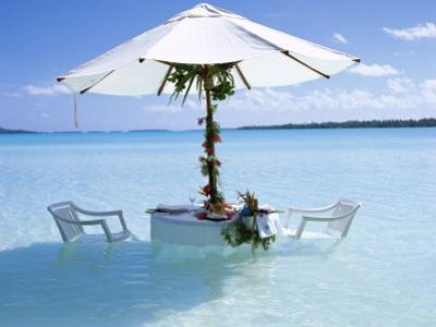 White Table, Chairs and Parasol in the Ocean, Bora Bora (Borabora), Society Islands by Mark Mawson