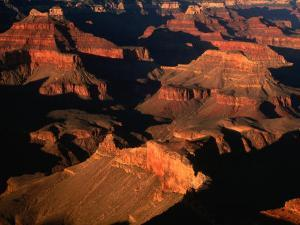 Aerial View of Sunlight Illuminating the Canyon Rims, Grand Canyon National Park, USA by Mark Newman