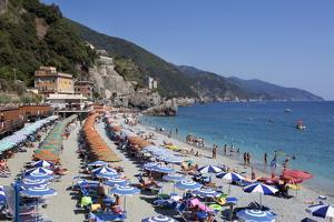 Umbrellas on the New Town Beach at Monterosso Al Mare by Mark Sunderland