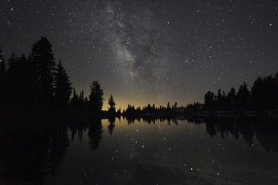 Lake at Night with Reflected Stars of the Milky Way and Silhouetted Trees, Lassen Volcanic Np, USA