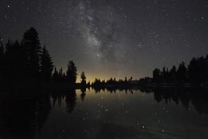 Lake at Night with Reflected Stars of the Milky Way and Silhouetted Trees, Lassen Volcanic Np, USA by Mark Taylor