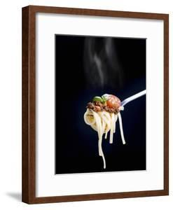 Linguine with a Minced Meat Sauce, Tomatoes and Basil on a Fork by Mark Vogel