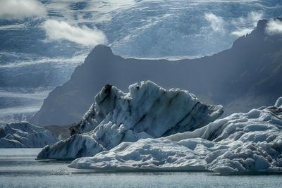 Iceland, floating glaciers in Jokulsarlon, glacier lagoon with mountain echo.
