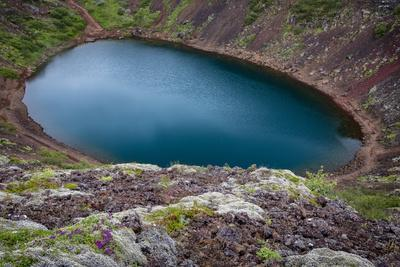 Iceland, Kerid, Deep blue lake contained in the Kerid crater. Iceland's Golden Circle.