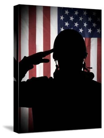 American (Usa) Soldier Saluting to USA Flag