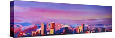 Denver Colorado Skyline with luminous Rocky Mounta