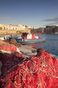 Fishing boats and fishing net at the port, old town, Gallipoli, Lecce province, Salentine Peninsula by Markus Lange