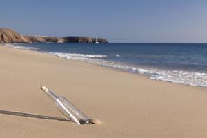 Message in a bottle, Playa Papagayo beach, near Playa Blanca, Lanzarote, Canary Islands, Spain by Markus Lange