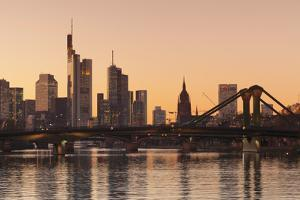 View over Main River to Floesserbruecke bridge and financial district, Frankfurt, Hesse, Germany, E by Markus Lange