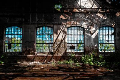 Abandoned Industrial Interior with Bright Light by maroti