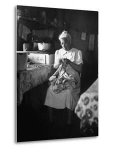 American Indian, Dr. L. R. Minoka Hill, Sewing in Kitchen Window Light by Martha Holmes