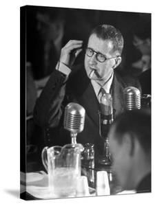 Berthold Brecht Smoking a Cigar During United Nations American Activities Hearing by Martha Holmes