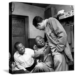Billy Eckstine backstage with ex-boss, orchestra leader Earl Hines and trumpeter Louis Armstrong by Martha Holmes