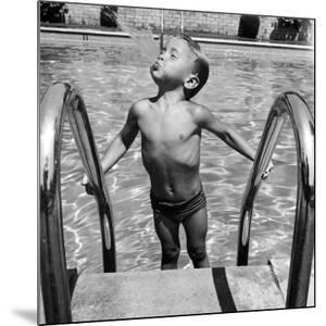 Duncan Richardson, 3-Year-Old Swimming Prodigy, Spouting Water Like a Whale, Town House Pool by Martha Holmes