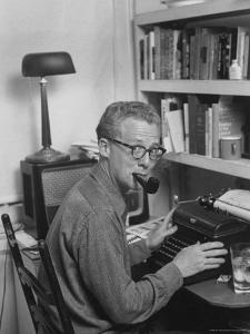 Excellent of Pulitzer Prize Winning Journalist Murray Kempton Smoking Pipe at Typewriter by Martha Holmes