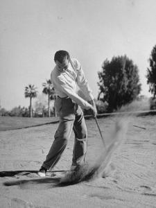 Golfer Ben Hogan Playing Golf in Sandtrap by Martha Holmes
