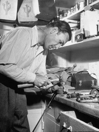 Golfer Ben Hogan Working on Golf Club in Workshop