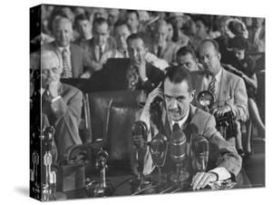 Howard R. Hughes Testifying at Hearing Before the Senate War Investigation Committee by Martha Holmes