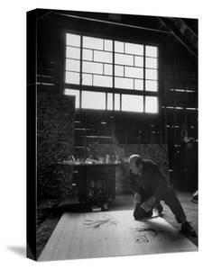 Jackson Pollock Working on a Painting by Martha Holmes
