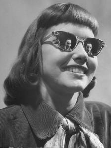 Model Lilly Fernandez Wearing a Pair of Mirror Glasses by Martha Holmes