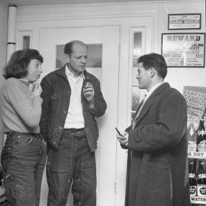 Painter Jackson Pollock and Lee Krasner Talking with Guest by Martha Holmes