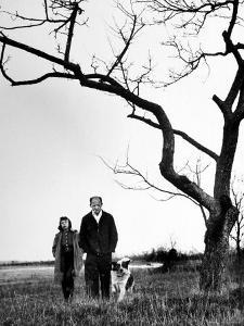 Painter Jackson Pollock Walking in Field with Wife Lee Krasner by Martha Holmes