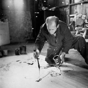 Painter Jackson Pollock Working in His Long Island Studio Adjacent to His Home by Martha Holmes