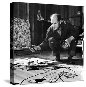 Painter Jackson Pollock Working in His Studio, Cigarette in Mouth, Dropping Paint Onto Canvas by Martha Holmes