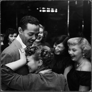 Singer Billy Eckstine Getting a Hug From an Adoring Female After His Show at Bop City by Martha Holmes