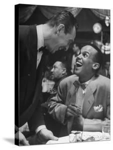 Singer Harry Belafonte, Looking Up and Laughing During Bop City Nightclub's Opening Night by Martha Holmes