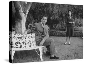 Surrealist Artist Salvador Dali with His Wife Gala in a Garden by Martha Holmes
