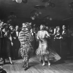 The Tiger Getting Expert Instructions from the Lady, During Charleston Party by Martha Holmes
