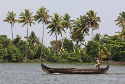 Fisherman in Traditional Boat on the Kerala Backwaters, Kerala, India, Asia
