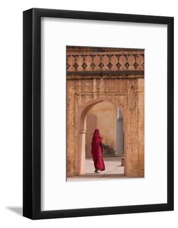 Lady in Traditional Dress Walking Through a Gateway in the Amber Fort Near Jaipur, Rajasthan, India