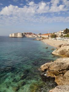 Old Town and Rocky Shoreline, Dubrovnik, Croatia, Europe by Martin Child