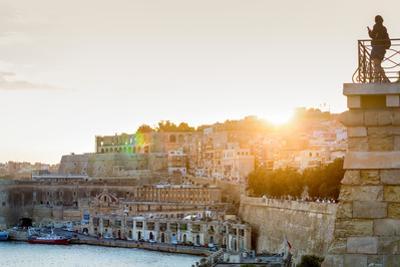 Person photographing the Grand Harbour in Valletta at dusk. Valletta, Malta, Mediterranean, Europe by Martin Child