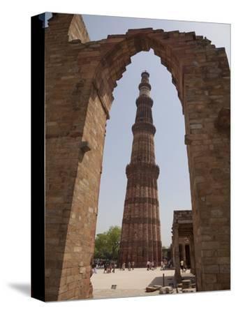 Qutb Minar Through Arch, Qutb Complex, Delhi, India, Asia