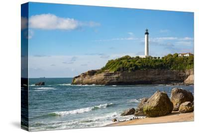 Rocks on the Sandy Beach and the Lighthouse in Biarritz, Pyrenees Atlantiques, Aquitaine