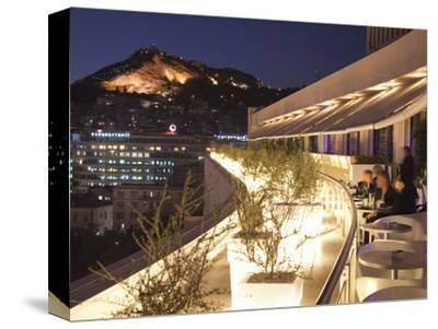 Rooftop Terrace Bar at the Athens Hilton with Lykavittos Hill Illuminated at Night, Athens, Greece,