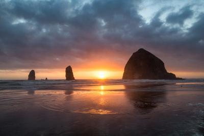 Sunset behind Haystack Rock at Cannon Beach on the Pacific Northwest coast, Oregon, United States o by Martin Child