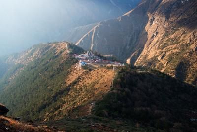 A bird's-eye view of Tengboche monastery, surrounded by mountain slopes. by Martin Edstrom